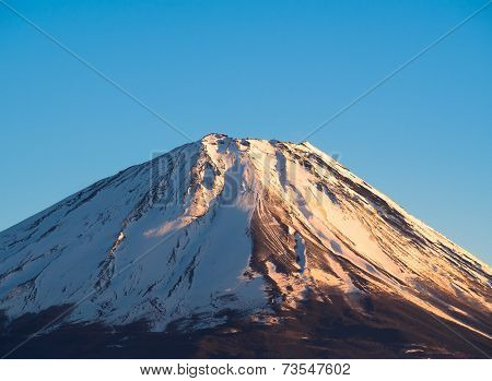 The top of Mount Fuji covered in snow