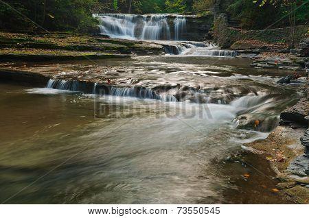 waterfall in creek at autumn