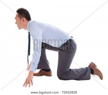Asian business man on starting line of a race, side view full length isolated over white background.