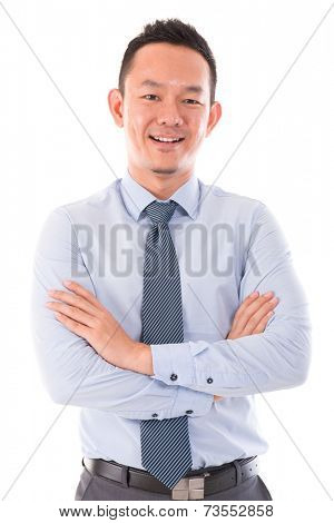Asian business man smiling, standing isolated over white background.