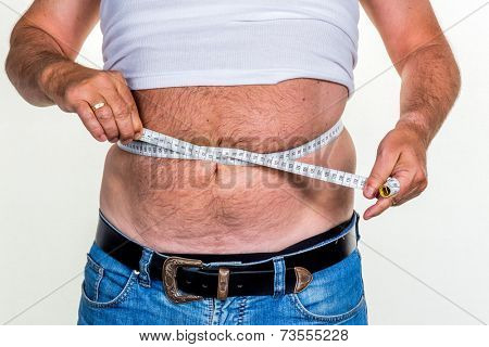 man with overweight. symbol photo for beer belly, unsuccessful diets and poor diet.