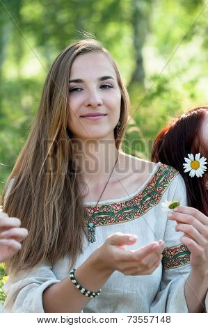 Beautiful brunette woman with camomile