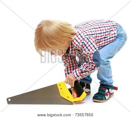 Little boy sawing saw.