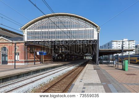 Passengers Waiting At A Train Station Of The Hague, The Netherlands