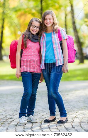 Teen Friends With Schoolbag