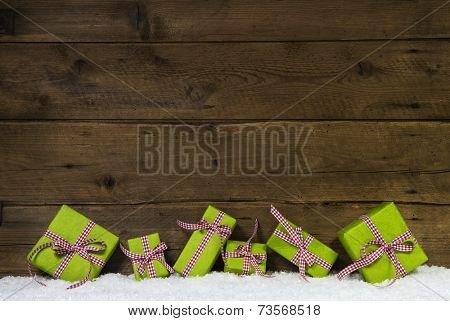 Apple green christmas presents on wooden background for a gift certificate.