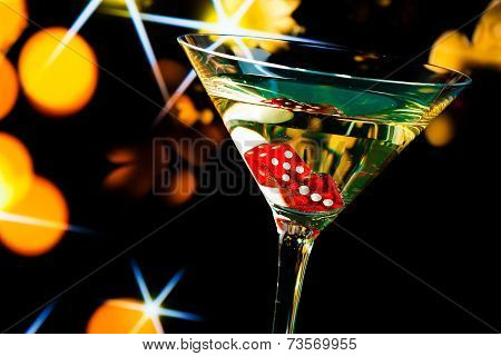 Red Dice In The Cocktail Glass On Gold Bokeh And Stars