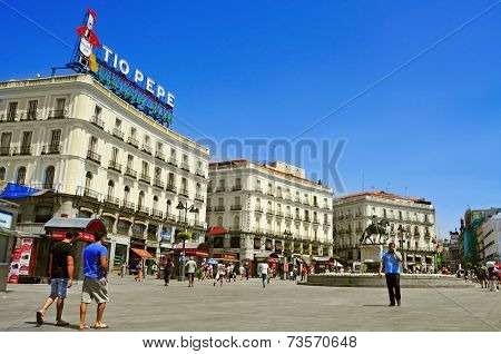 MADRID, SPAIN - AUGUST 11: People walking in Puerta del Sol square on August 11, 2014 in Madrid, Spain. This popular pedestrian square is one of the busiest place in the city