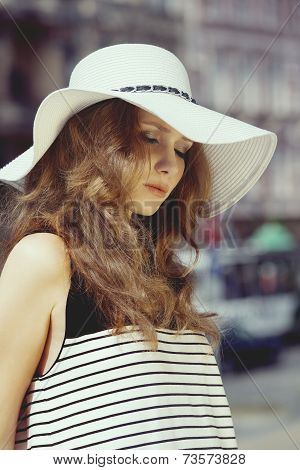 Woman In Summer Hat Outside