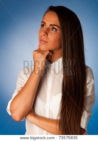 Pensive Young Hispanic Woman Thinking In Front Of Blue Background