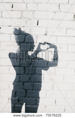 Portrait Of A Young Woman Forming A Heart With Her Hands