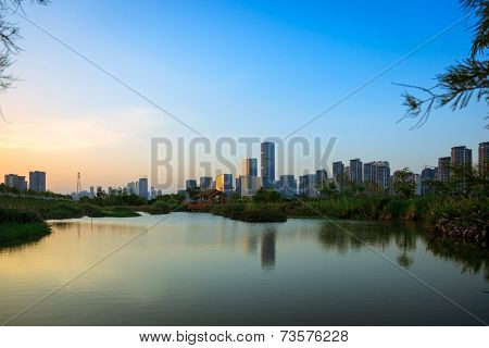 Water garden and the skyscrapers of city's central business district,Fuzhou,China