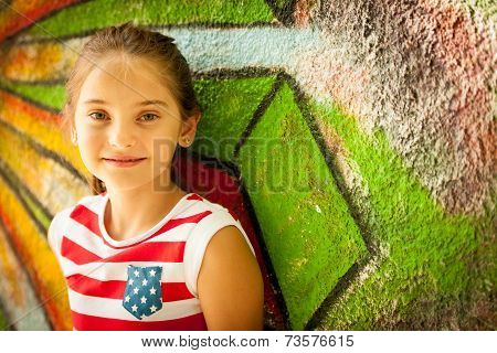 Young Girl Standing Near Graffiti Wal On Summer Afternoon