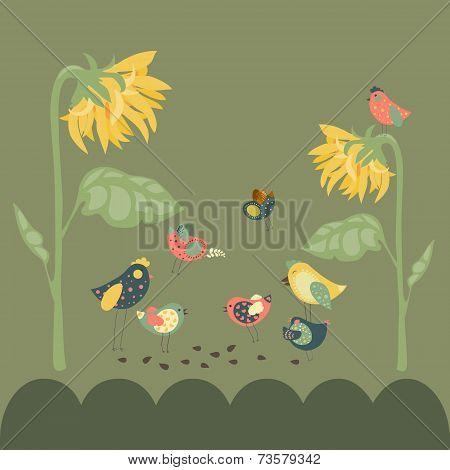Birds pecking sunflower seeds