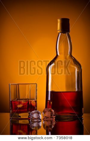 Whiskey Bottle, Ice And Glass