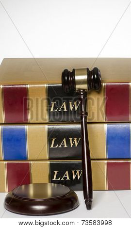 Law books, gavel and wood block