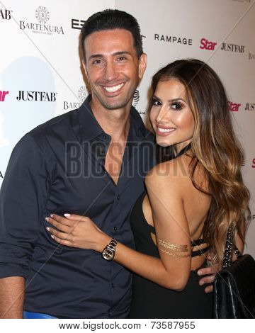 LOS ANGELES - OCT 9:  Bobby Panahi, Asifa Mirza at the Star Magazine Scene Stealers Event at Lure on October 9, 2014 in Los Angeles, CA