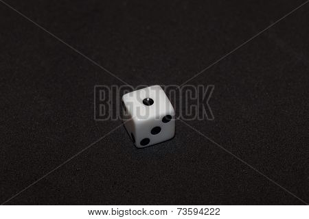 White Dice With Black Numbers In Black Background, Number One
