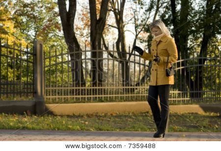 Young Woman Walking At Autumn Park.