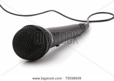 The big black microphone on a white background.