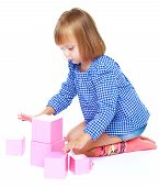 pic of inflatable slide  - Girl playing with blocks on a white background - JPG