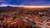 stock photo of yellow castle  - A sunset view of the centre of Ljubljana from the castle hill Slovenia - JPG