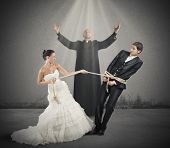 foto of marriage ceremony  - A man trapped with rope by marriage with the priest during the ceremony - JPG