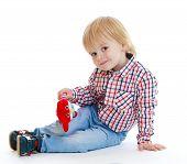 foto of montessori school  - Little boy sitting on the floor teddybear  - JPG