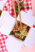 pic of chinese checkers  - Chinese noodles and sticks in takeaway box on fabric background - JPG