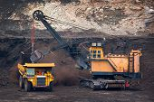 picture of open-pit mine  - big mining truck unload coal in coal mine - JPG