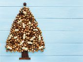 pic of hazelnut tree  - Christmas tree made of nuts cinnamon and anise - JPG