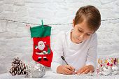 pic of letters to santa claus  - Boy writes a letter to Santa Claus - JPG