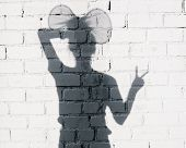 stock photo of fool  - Girl fooling around on the brick wall background - JPG