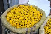 stock photo of haldi  - Turmeric in a bag at the indian spice market - JPG