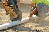 stock photo of cut  - Infrastructure excavation building contractors cutting water lines for a utility trench at a commercial residential development - JPG