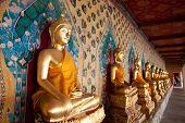 image of brighten  - Brighten religious statues icon in temple of dawn Bangkok - JPG