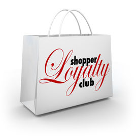 picture of loyalty  - Shopper Loyalty Club words on a store shopping bag as a promotional rewards program for customers and consumers - JPG