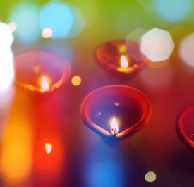 picture of diya  - An abstract colorful Diwali greeting card cover with traditional diyas - JPG