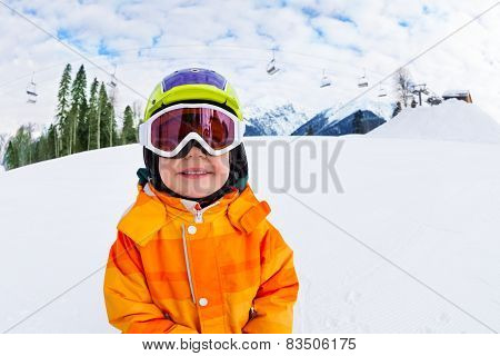 Close-up of smiling boy wearing ski mask in winter