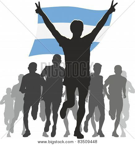 Athlete with the Argentina flag at the finish