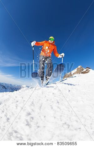 Young man skiing in motion view from below