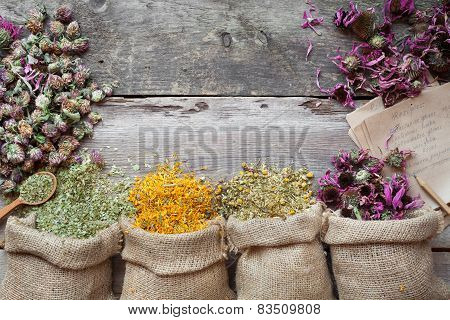 Healing Herbs In Hessian Bags On Old Wooden Rustic Table, Herbal Medicine. Top View.