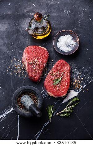 Raw Fresh Meat Rump Steak And Seasonings On Dark Marble Background