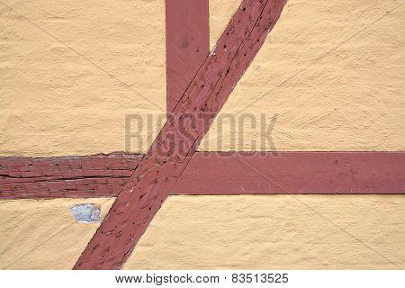 Closeup of yellow half-timbered wall