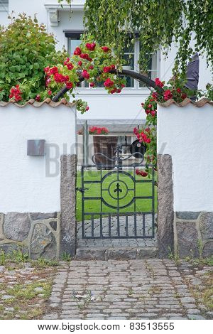 Pretty home entrance with white washed wall and roses