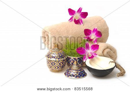 Thai Spa Massage Setting With Spa  Essential Oil , Towel, Organic Soap And Orchid