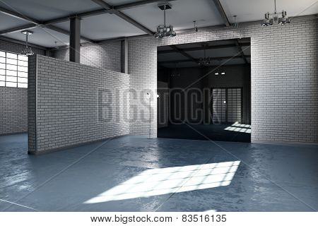 Empty room of a business or residential property with gray brick and concrete stained floor steel fr