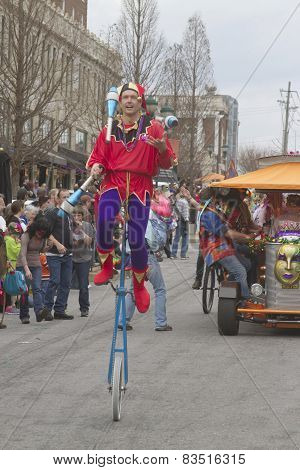 Mardi Gras Juggler On A Unicycle