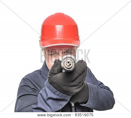 Worker Aims Drill.