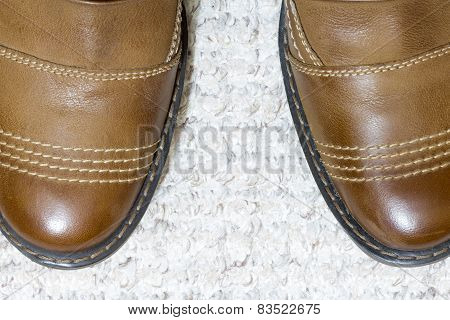Pair Of Men's Leather Shoes On Floor